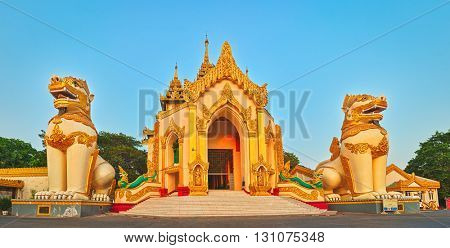 Western entrance of Shwedagon complex in Yangon. Myanmar. Panorama