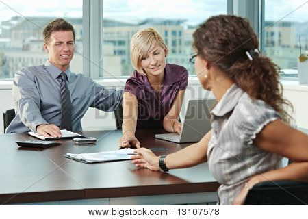 Young business people planning on table at office during business meeting.