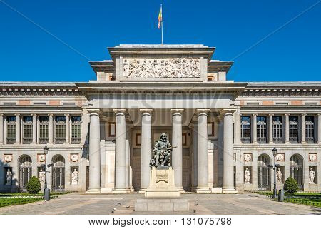 Entrance to Prado museum with Velazquez statue of Madrid in Spain
