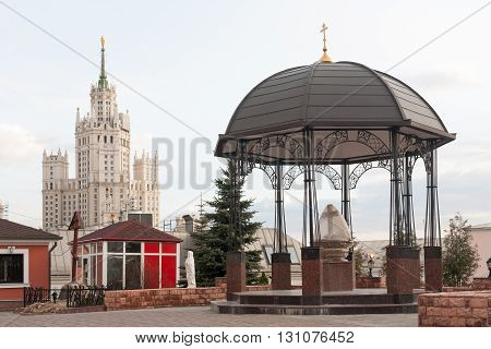 MOSCOW - APRIL 4: Gazebo near the Peter and Paul Cathedral and the Stalinist skyscraper at Kotelnicheskaya embankment on April 4 2016 in Moscow.