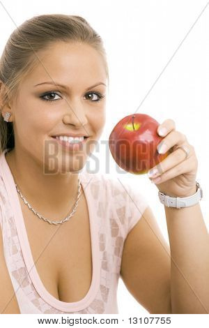 Portrait of beautiful girl holding a green apple, smiling, isolated on white.
