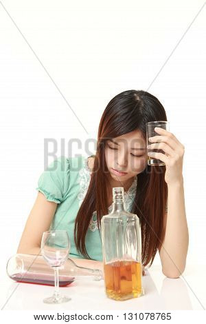 portrait of Japanese woman drunk too much on white background