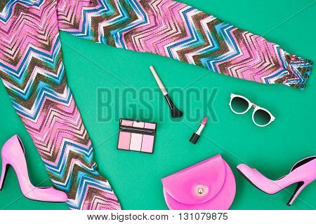 Urban summer girl colorful outfit. Fashion stylish clothes, cosmetics, makeup accessories. Stylish glamor pink heels, handbag clutch, trendy pants, sunglasses. Woman essentials. Unusual, top view