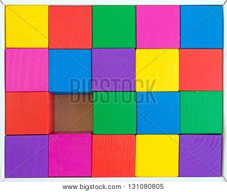 Children's toy - multicolored cubes in box (one cube is not enough) of rough-hewn wood (rough surface)