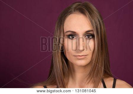 Beautiful Sad Woman Portrait on purple background.