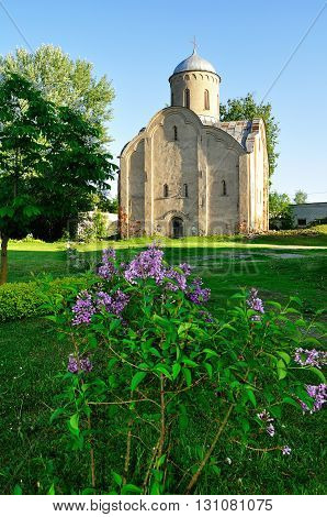 The medieval Orthodox church of Peter and Paul at Slavna in Veliky Novgorod Russia. Focus at the church architectural spring evening landscape