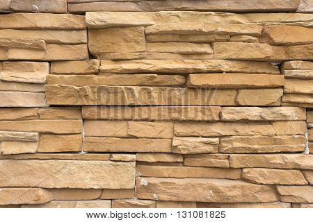 Masonry of thin layers stone of yellow-red color