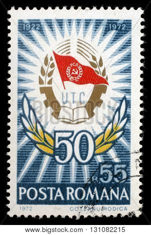 ZAGREB, CROATIA - JULY 19: a stamp printed in Romania shows Badge and laurel wreath, 50 Years Communist Youth League, circa 1972, on July 19, 2012, Zagreb, Croatia