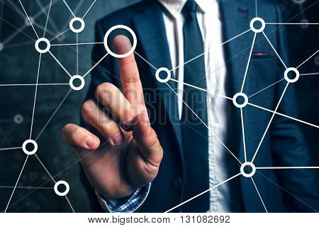 Businessman connecting the dots in business project management social networking or teamwork organization.