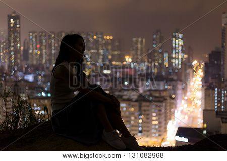 Woman enjoy the night view in Hong Kong