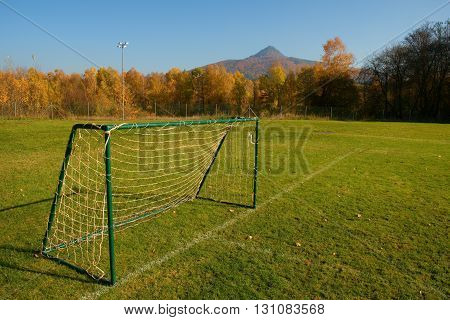 Old Football Gate On Village  Football Field. Sunny Day At The End Of Season, Poor Grass
