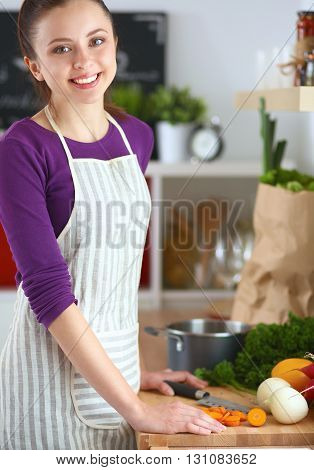 A young woman cooking in the kitchen