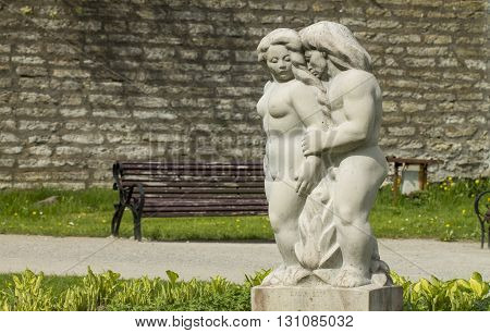 Tallinn Estonia - May 2016: Statue of man and woman hugging each other in the Old Town park in Tallinn.