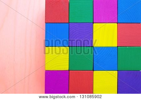 Children's toy - multicolored cubes of rough-hewn wood (rough surface)
