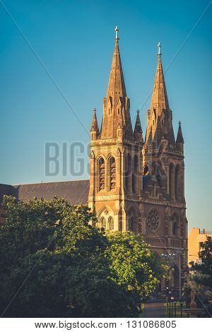 St. Peter's Cathedral of Adelaide at sunset South Australia. View from Pennington Gardens. Color-toning effect applied