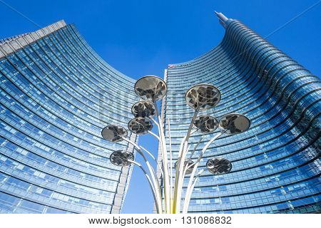 Milan Italy - January 24 2015: Porta Nuova the Solar Tree with the Unicredit Tower in the background
