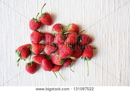 Strawberry on a white cloth in day light