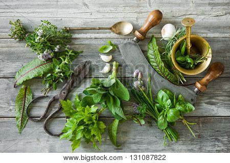 fresh kitchen herbs and spices on wooden table. Top view