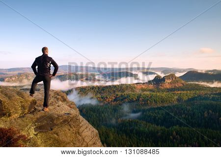 Adult Hiker Stand On Cliff Of Sandstone Empires Park And Watching Over The Misty And Foggy Morning V