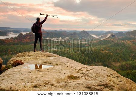Silhouette Of Tourist With Poles In Hand. Sunny Spring Daybreak In Rocky Mountains. Hiker With Sport