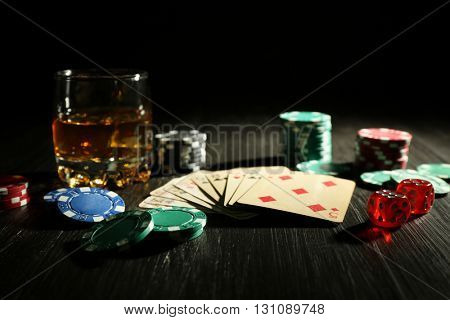Set to playing poker with cards and chips on wooden table closeup