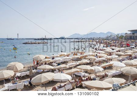 France, Cannes - August 6, 2013: People Relax On The Beach During The High Season.