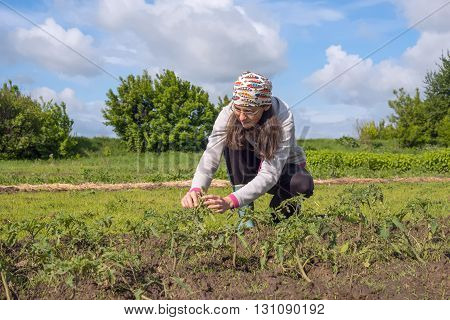 Woman farmer enthusiastically working on the field.