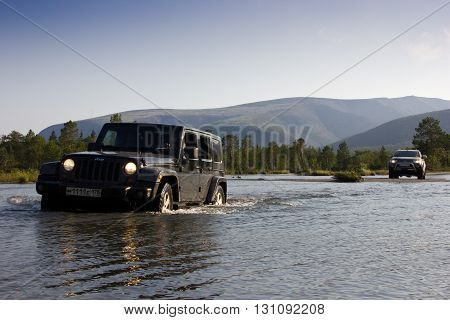 Kola Peninsula, Russia, August 5, 2014: Journey to the Jeep Wrangler unlimited Sahara on the Kola Peninsula. Wrangler is a compact four wheel drive off road and sport utility vehicle