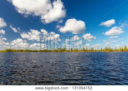 lake landscape in summer and blue sky with clouds