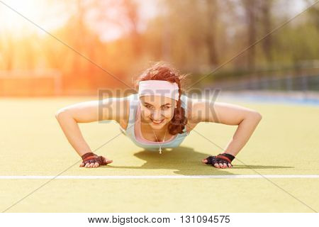 Young Athletic Woman Doing Core Exercise Outdoors