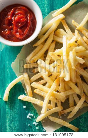 french fries with ketchup over green background