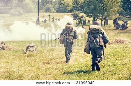 NITRA SLOVAK REPUBLIC - MAY 21: Reconstruction of the Second World War operations between Red and German army german soldiers attacks the russian defense units on May 21 2016 in Nitra Slovak Republic.