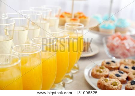 Set of cold snacks, canape, beverages and dessert, closeup