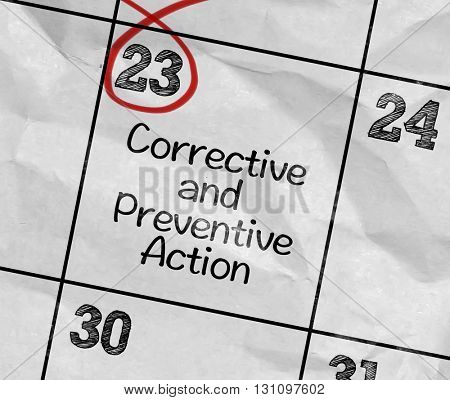 Concept image of a Calendar with the reminder: Corrective and Preventive Action