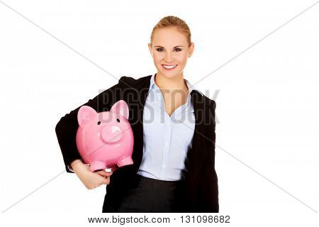 Young business woman holding  piggybank
