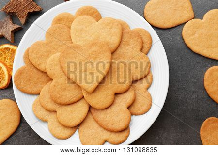 Heart shaped biscuits on plate, top view