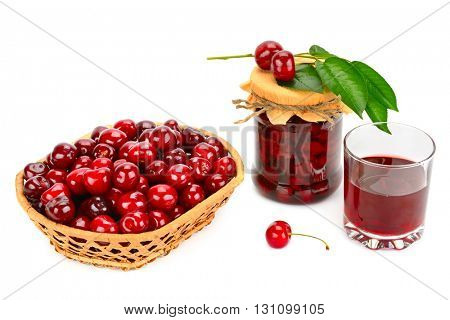 Glass of juice, basket of cherries and jar of jam isolated on white background