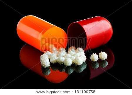 Closeup of medical capsule on a black background