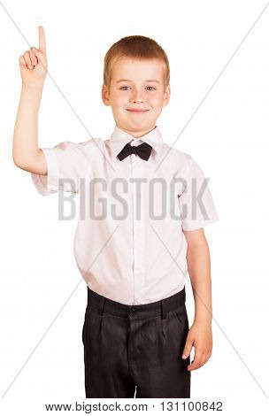 Cute boy in a school uniform shows thumb up isolated on white background.