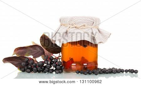 Elderberry and drink of rose hips isolated on a white background.