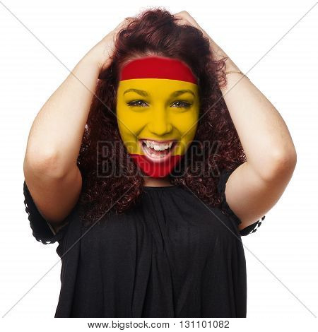 girl with spanish flag face paint. female soccer fan from spain