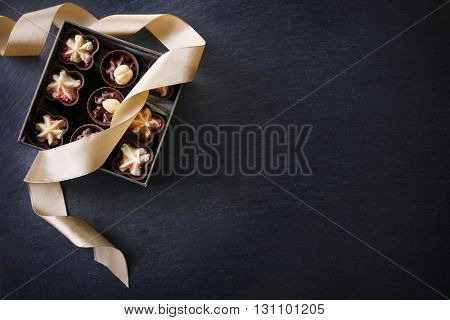 Chocolate sweets on wooden background