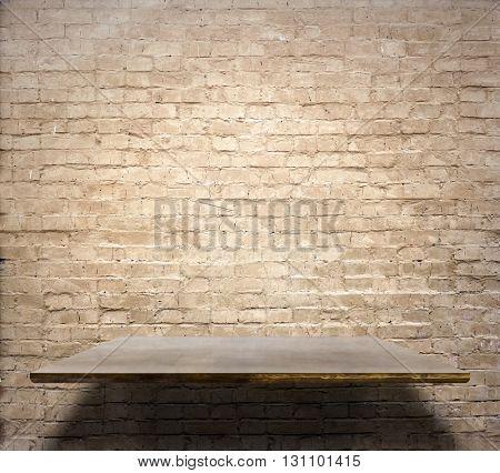 empty shelves on brick wall