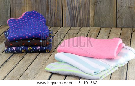 childrens fancy things neatly stacked on wooden background space for text