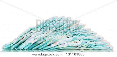Lots of baby diapers isolated on white background.