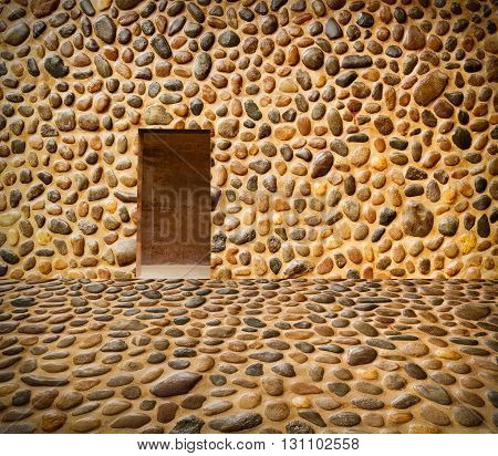 Stone Wall With Door And Stone Floor In Front Off