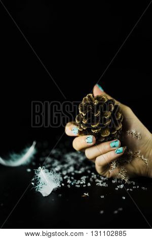 hands with beautiful nails on a black background with decor