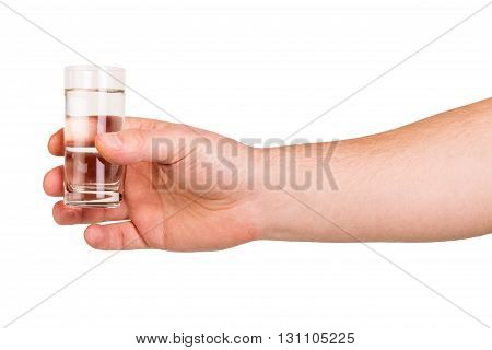 Man's hand keeps the glass vodka isolated on white background.