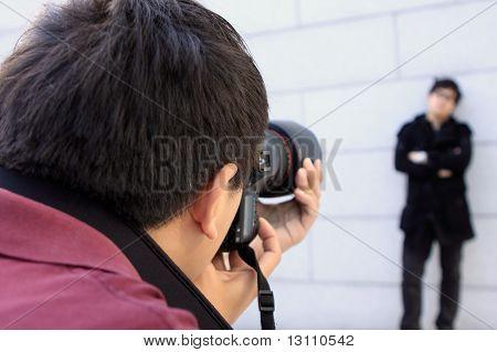 Young Man Photographer Doing Photos By Digital Camera