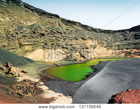 beautiful green lake Lago Verde inside crater on Lanzarote, Canary Islands, Spain